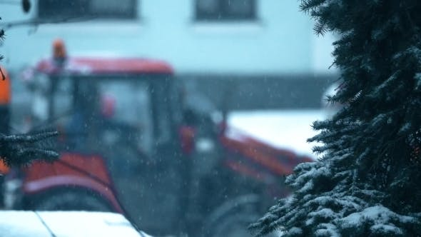 Thumbnail for Tractor and Road Workers at Snow Removal Work on a Street