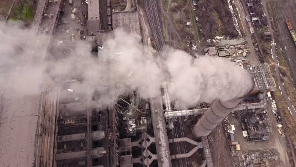 Cover Image for Aerial View. Emission To Atmosphere From Industrial Pipes. Smokestack Pipes Shooted with Drone. .