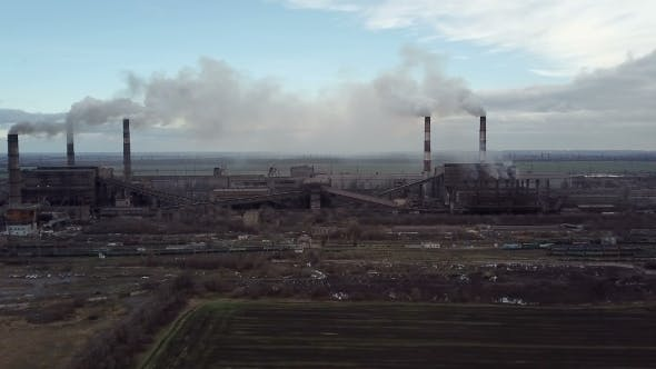 Thumbnail for Emission To Atmosphere From Industrial Pipes Smokestack Pipes Shooted with Drone. .