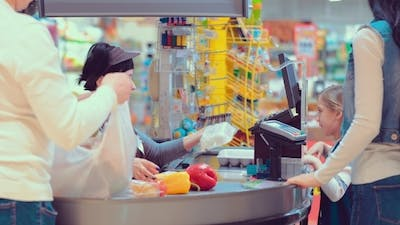 Cash Desk with Cashier and Terminal in Hypermarket