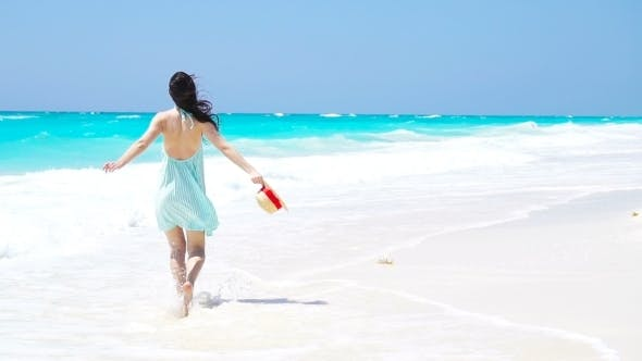 Thumbnail for Young Beautiful Woman on White Sand Tropical Beach