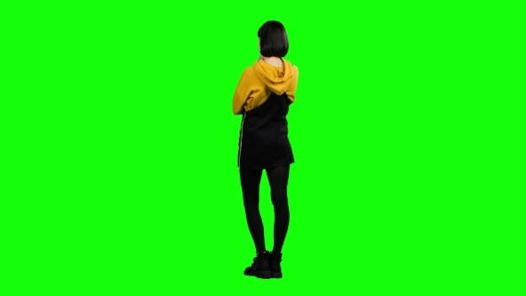 Thumbnail for Teenager Stands with His Back To the Audience and Virtually Draws a Drawing. Green Screen