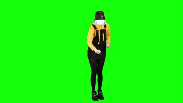 Thumbnail for Teen Looks Into Vr. Green Screen
