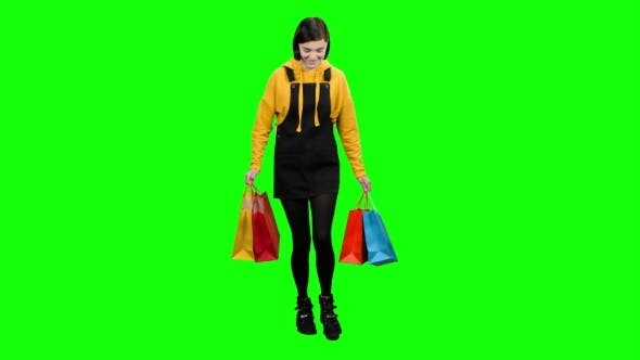 Thumbnail for Girl with Bags in Her Hands After Shopping Is Happy Shoppin