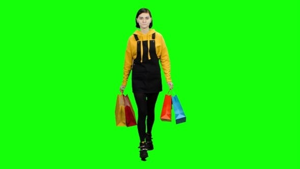 Thumbnail for Girl Is Walking Along the Street with Packages in Her Hands