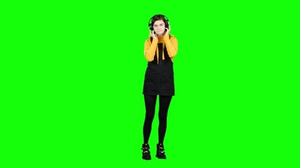 Thumbnail for Teenager Listens To Music on Headphones. Green Screen