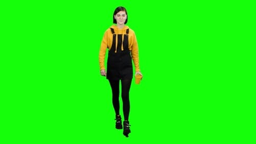 Teenager Is Drinking Tea on the Go. Green Screen