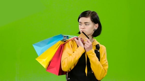 Thumbnail for Teenage Girl Goes Shopping with Packages and a Credit Card in Hand