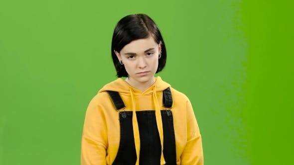 Thumbnail for Teenage Girl Looks Forward Angrily. Green Screen