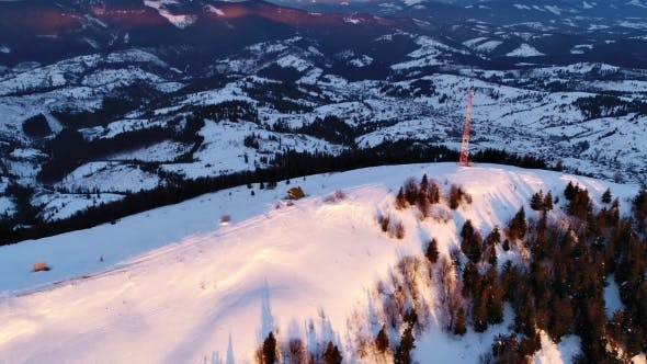 Thumbnail for Flying Over Communications Tower, Mountain Snow Covered Winter Landscape