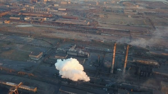 Thumbnail for Emission To Atmosphere From Industrial Pipes Smokestack Pipes Shooted with Drone Aerial View