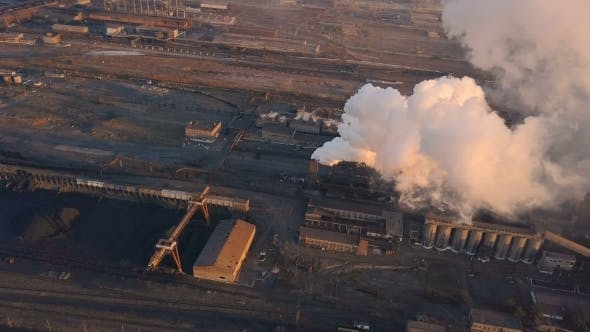 Emission To Atmosphere From Industrial Pipes Smokestack Pipes Shooted with Drone Aerial View