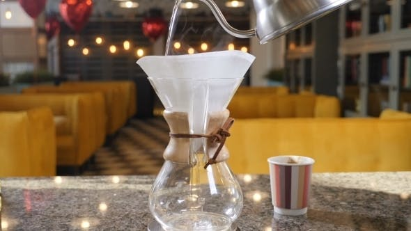Thumbnail for Modern and Alternative Ways of Coffee making Barista Brews Coffee Using Coffee Maker Chemex