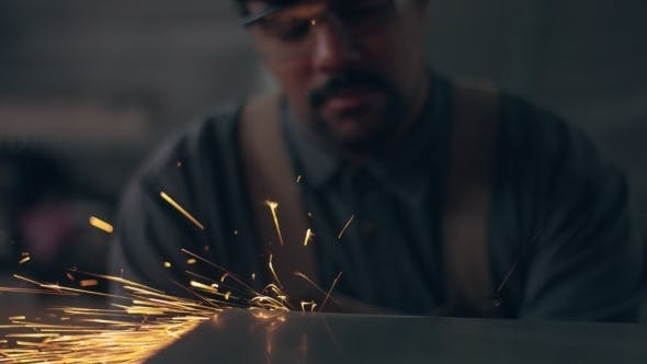 Thumbnail for Worker Using Industrial Grinder