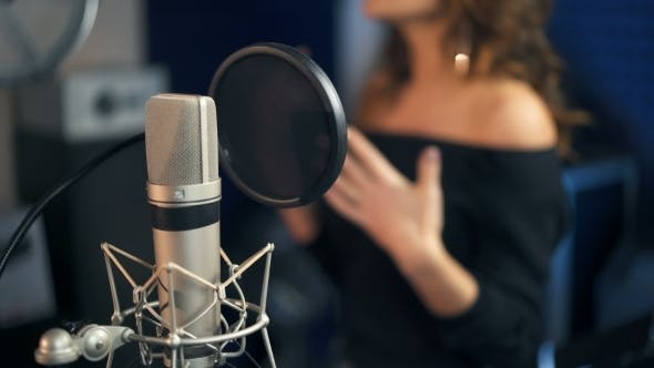 Thumbnail for Professional Microphone in the Recording Studio Background of a Singing Woman