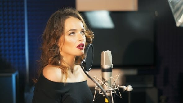 Thumbnail for Beautiful Sexy Young Woman Singing. Female Vocal. Professional Recording Studio.