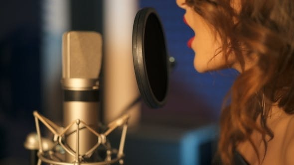 Thumbnail for Young Woman Recording a Song in a Professional Studio