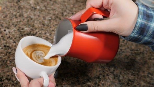 Making Coffee Barista Prepares Coffee Preparation of Latte Barista Pouring Hot Milk Into a Mug of