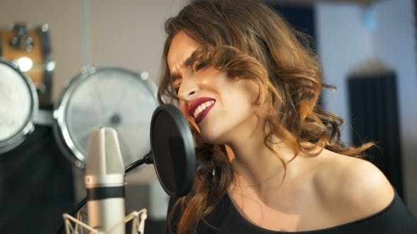 Thumbnail for Young Female Singer Recording Album in the Professional Studio. Woman Singing a Song in Music