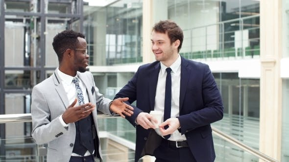 Thumbnail for Two Multiethnic Male Employees Consulting in Office