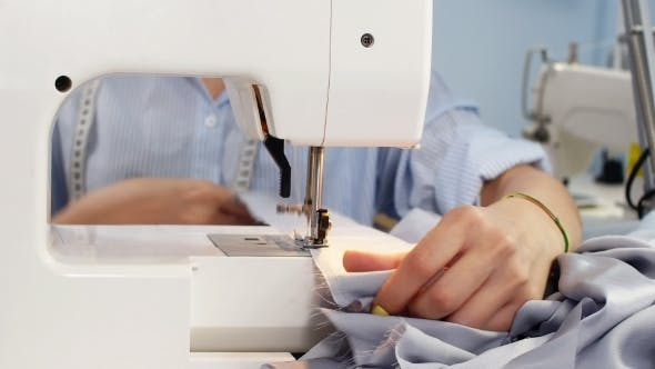 Thumbnail for Sewing Machine and Dressmaker in Working Process. Sewing Business. Needlework