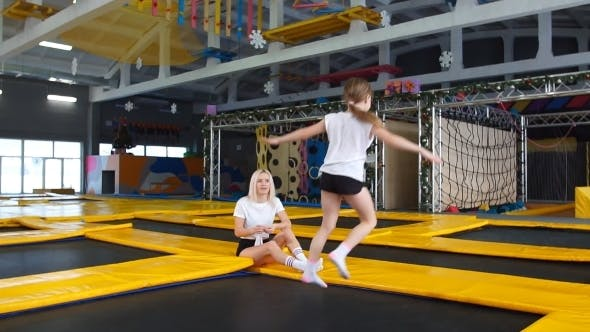 Thumbnail for Daughter Bouncing On Trampoline While Her Mother Watch for Safety