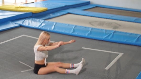 Thumbnail for Sportsman Jumping on a Trampoline and Doing Split Indoors