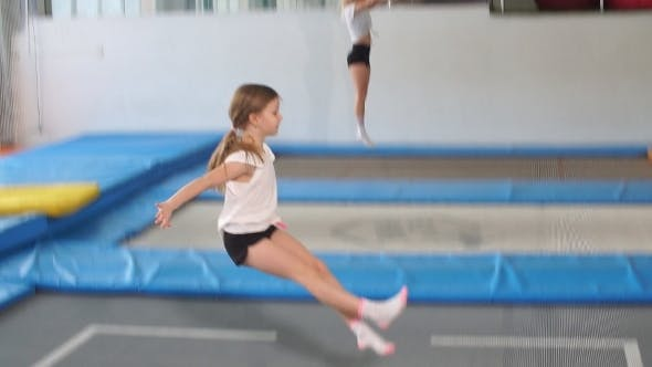 Thumbnail for Girl Jumping High in Striped Tights on Big Trampoline