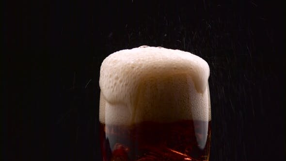 Thumbnail for Cola Pouring into Glass with Ice Cubes and It Overflows with Foam