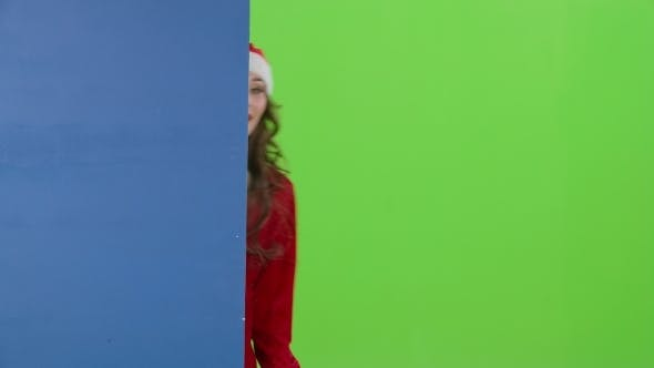 Thumbnail for Santa Woman Looks Out of the Blue Board and Shows a Thumbs Up. Green Screen