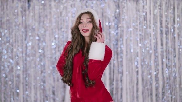 Thumbnail for Santa Claus Girl Posing for Cameras on Bokeh Background