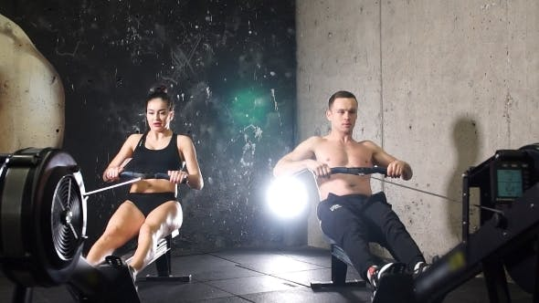 Thumbnail for Two Athletes Working On Rowing Machine