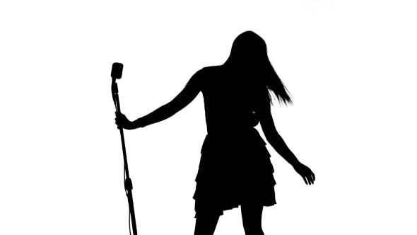 Thumbnail for Silhouette of Singer Dancing, Making Vigorous Movements & Begining to Sing on White Background
