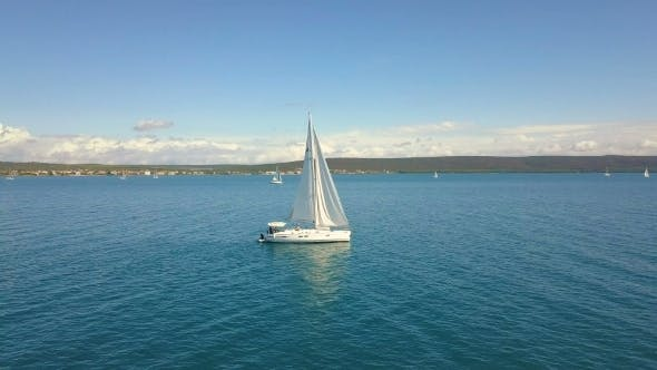 Thumbnail for Yacht Sailing on Opened Sea. Sailing Boat. Yacht From Drone. Yachting Video. Yacht From Above