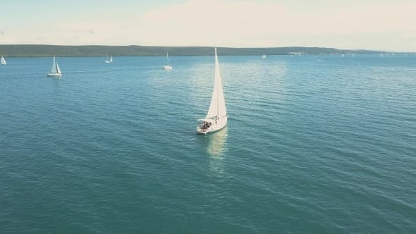Cover Image for Aerial View of Yacht Sailing Near Beautiful Islands