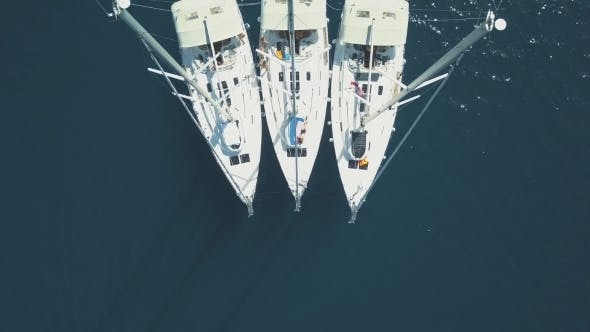 Thumbnail for Aerial View of Three Sailing Yachts Are Connected, Near Beautiful Islands