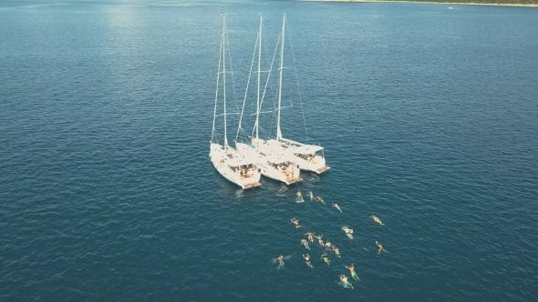 Thumbnail for Aerial View of Three Sailing Yachts Are Connected, Near Beautiful Islands. Beautiful Clouds in the