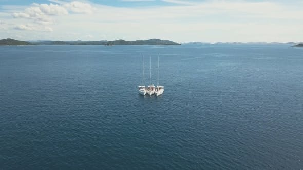 Thumbnail for Three Sailing Yachts Are Connected, Near Beautiful Islands. Beautiful Clouds in the