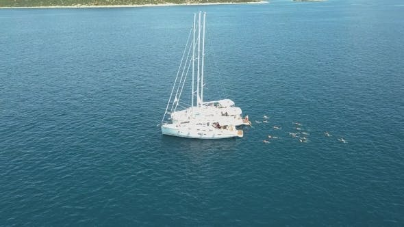 Aerial View of Three Sailing Yachts Are Connected