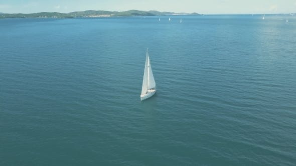 Thumbnail for Aerial View of Yacht Sailing Near Beautiful Islands. Beautiful Clouds in the Background