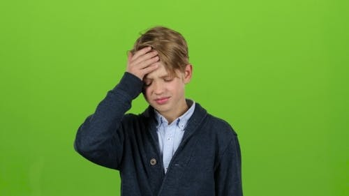 Child Is Tormented by Severe Headaches on Green Screen