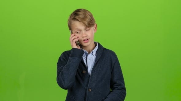 Thumbnail for Child Is Talking on the Phone and Screaming on Green Screen