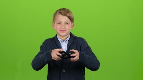 Boy Plays on the Joysticks on Green Screen