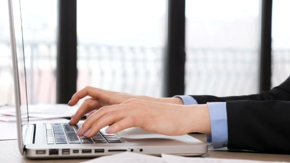 Thumbnail for Businesswoman Hands Typing on the Laptop Keyboard