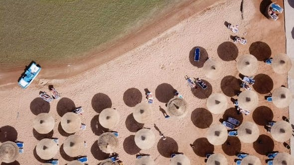 Thumbnail for Umbrellas, Deck Chairs and Tourists Relaxing on the Beach