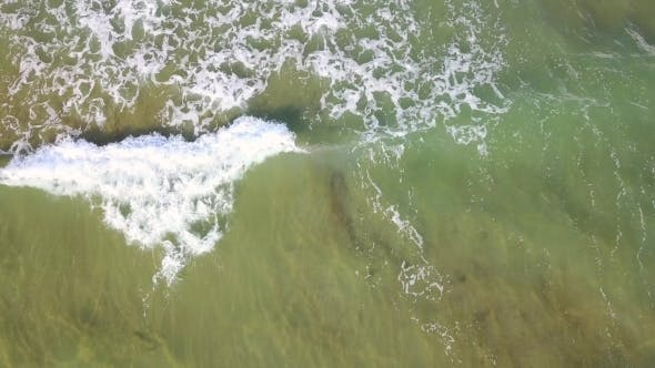 Thumbnail for Aerial View of the Foaming Turquoise Waves