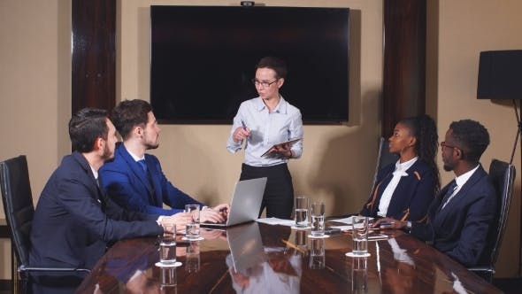 Thumbnail for Female Manager Standing To Address Team at Business Meeting.