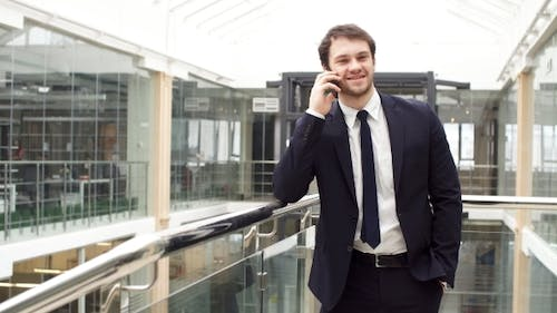Enthusiastic Business Man While Talking on Mobile Phone.