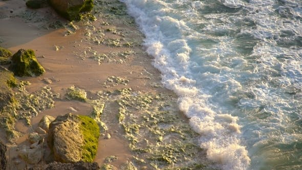 Cover Image for A View From Above a Beautiful Rocky Coast Covered with Green Algae in Balangan Beach, Bali