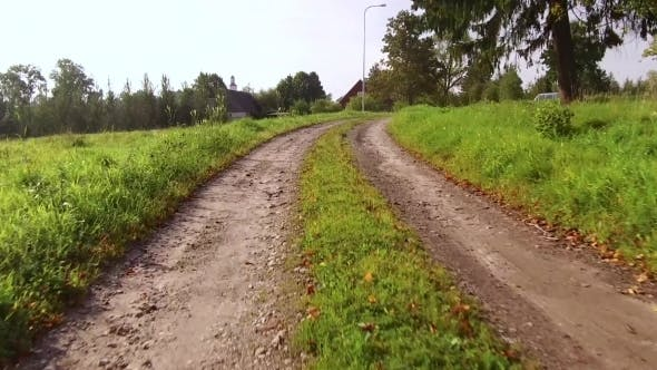Thumbnail for Movement on a Dirt Winding Road Gradually Turns in the Road with Improved Surface